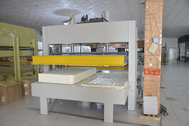 Mattress pressing and packing machine
